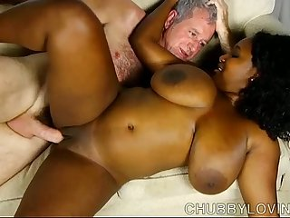 Beautiful busty black BBW fucks a lucky white guy