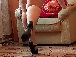 A fat girl in pantyhose and heels masturbates her pussy.