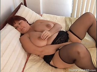 Beautiful busty MILF in stockings